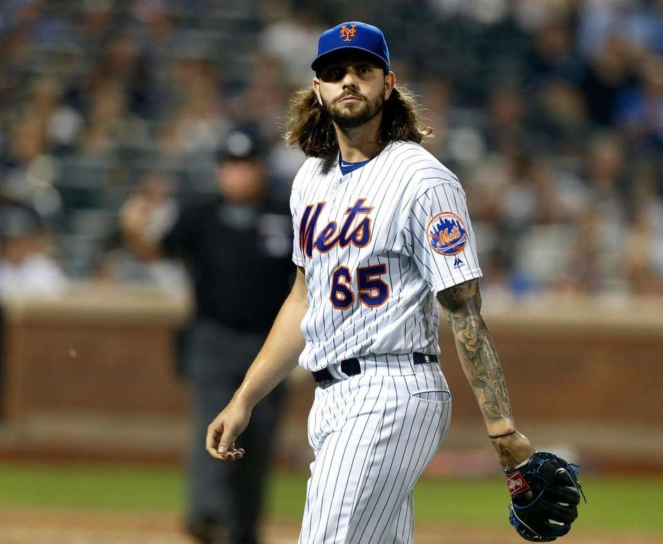 Robert Gsellman of the Mets walks to the
