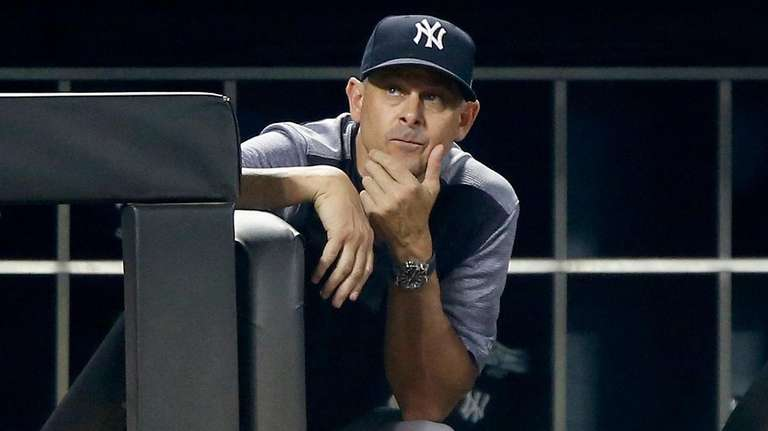 Yankees manager Aaron Boone looks on during the