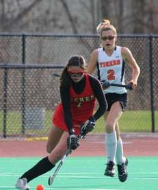 Sachem East's Katie Trombetta fights for the ball