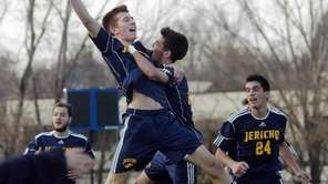 Jericho's Derek Medolla, center left, celebrates his goal