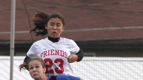 Friends Academy's Kristina Kim goes over Rachel Pines