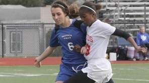 Friends Academy's Alexis Toles drives past Alice Haydan