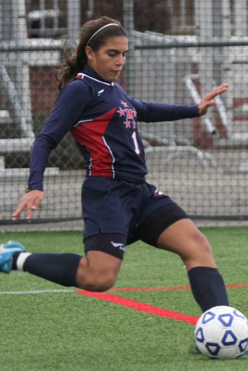 MacArthur's Arianna Montefusco sends the ball towards the