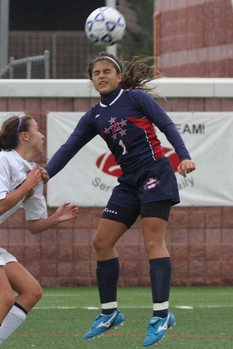 MacArthur's Arianna Montefusco heads the ball during their