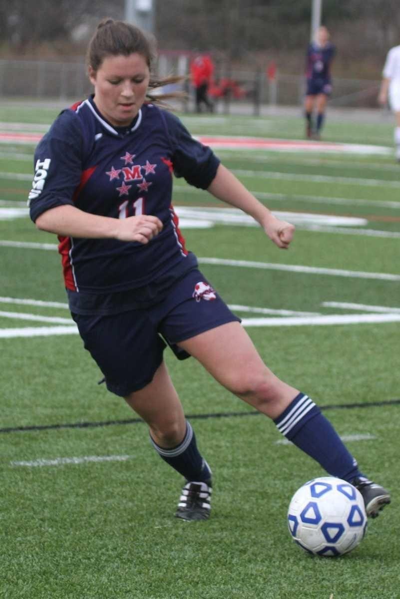 MacArthur's Jill Mulholland brings the ball up field