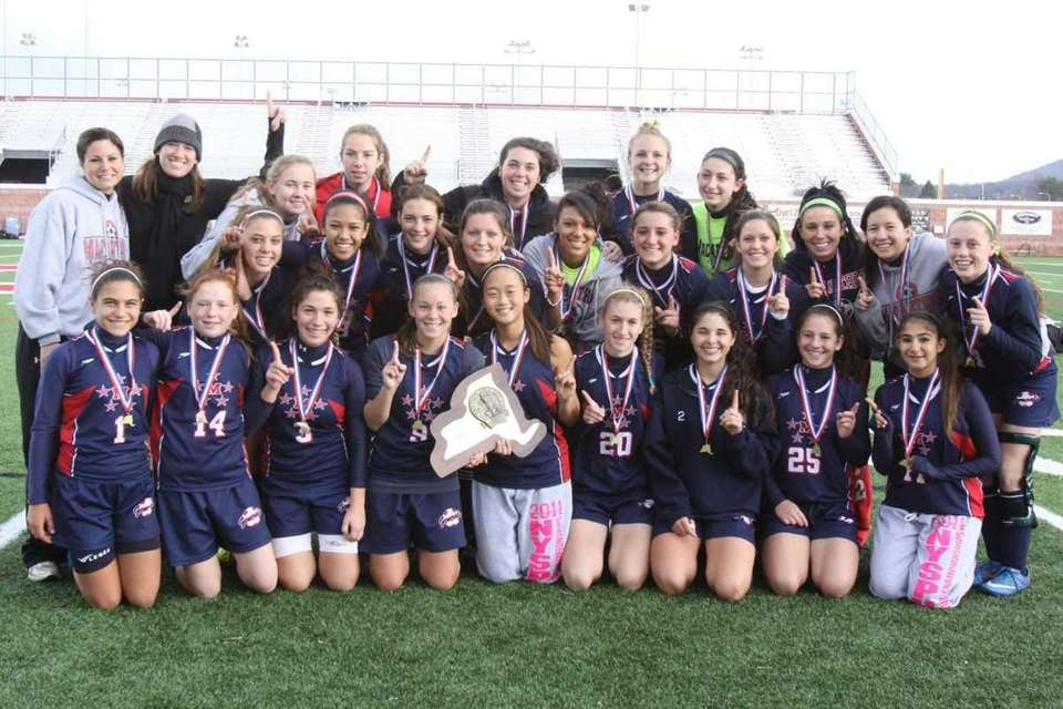 MacArthur's team celebrate their championship plaque after their