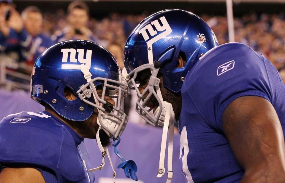 Running backs Da'Rel Scott, left, and Brandon Jacobs