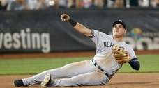 Yankees third baseman Gio Urshela throws from the