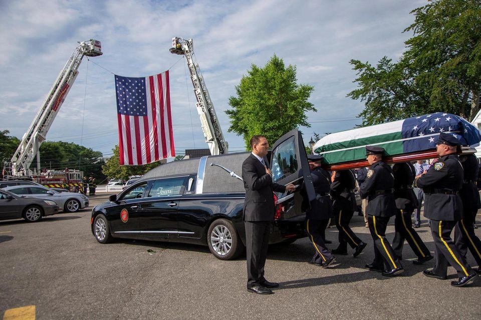 The casket for Luis Alvarez, the NYPD detective