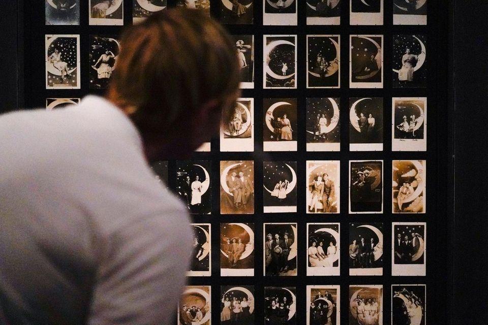 A person looks at Paper Moon Studio Portraits