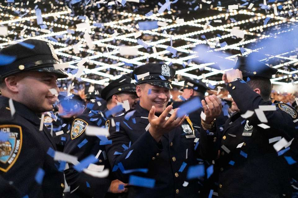 New NYPD police officers celebrate during their academy