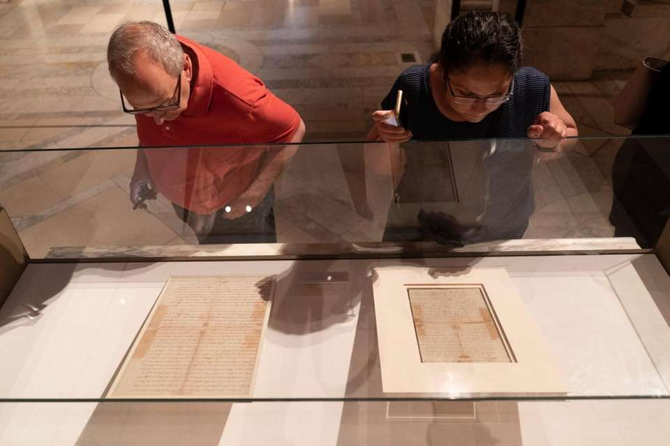People view a rare copy of the Declaration
