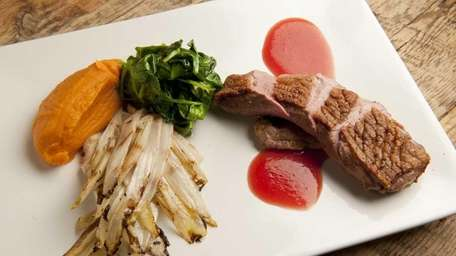 An entree of Long Island duck breast is