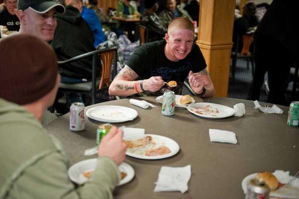 Army veteran Eric Reilly of Shirley eats a