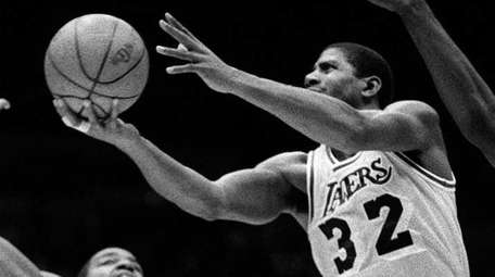 The Los Angeles Lakers' Magic Johnson, (32), goes