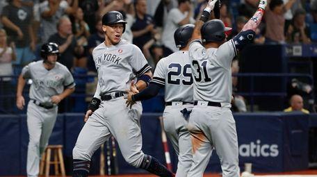 New York Yankees' Aaron Judge, left, celebrates with