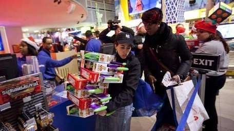 A shopper carries a stack of Toy Story