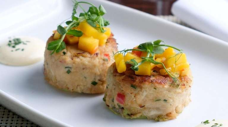 Savory jumbo lump crabcakes with mango salsa and