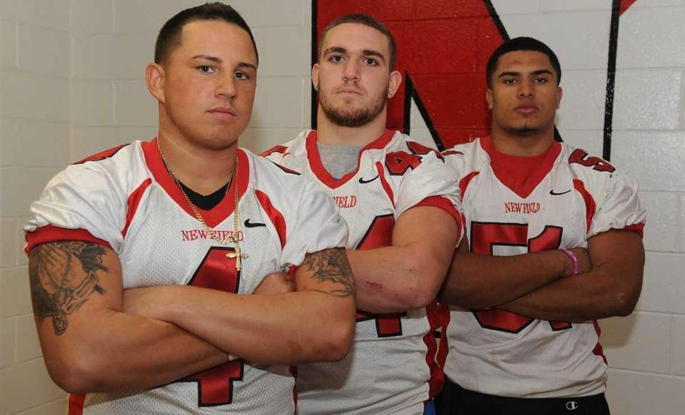 Newfield High School linebackers, from left, Tommy Diubaldo,