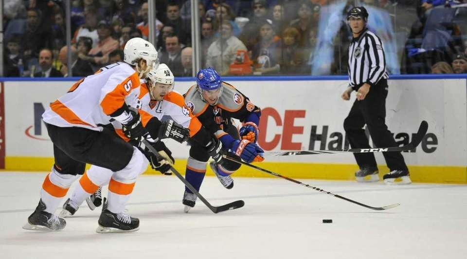 Braydon Cobern and Danny Briere of the Flyers
