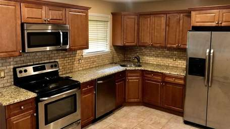 The kitchen inside an Islip home available as