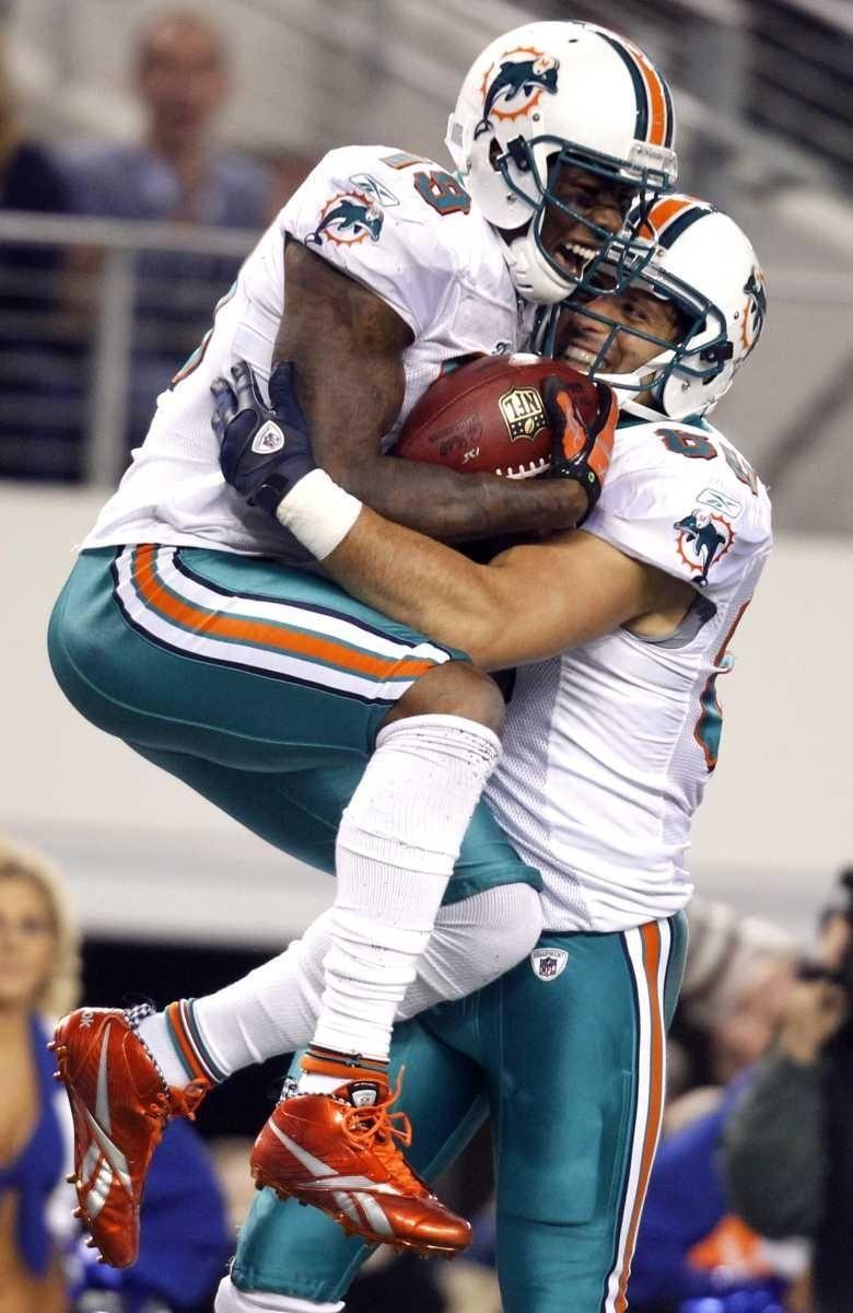 Miami Dolphins wide receiver Brandon Marshall (19) celebrates