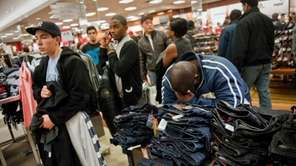 Shoppers wait in line to purchase their items