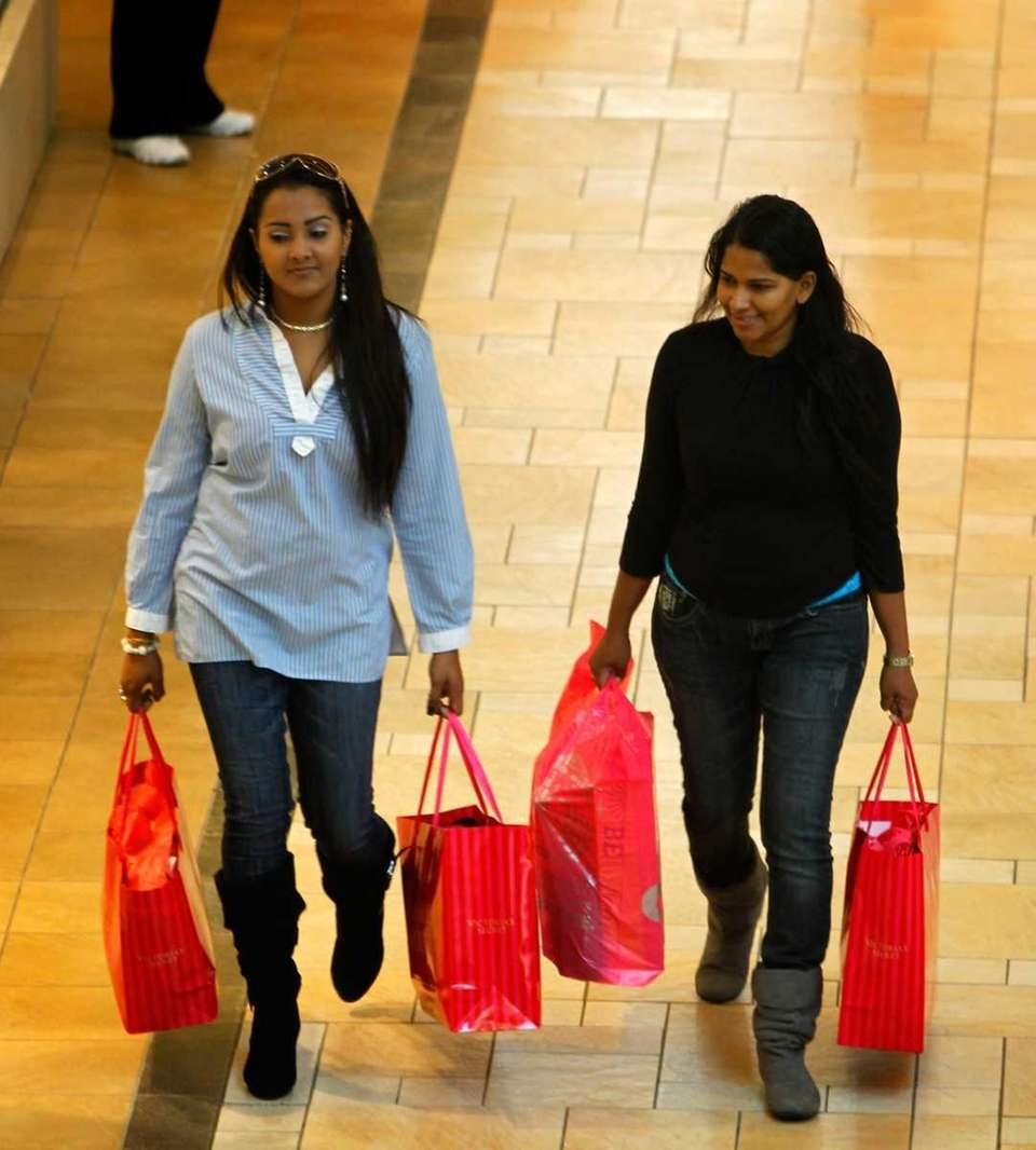 Black Friday shoppers make their way around the