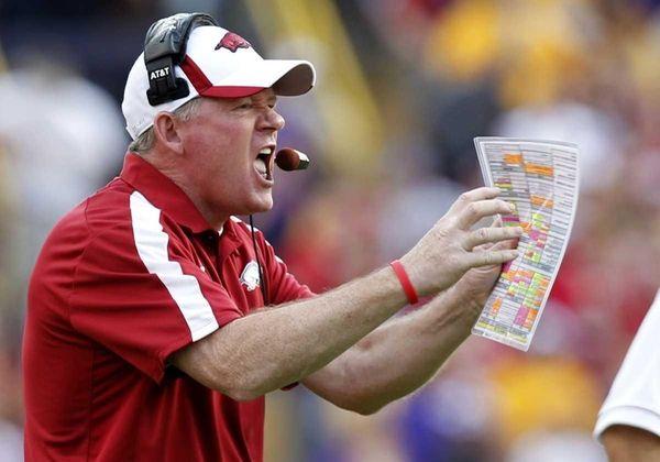 Arkansas head coach Bobby Petrino calls out to