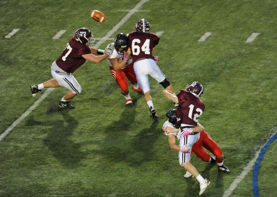 Garden City QB #12 Mike Comiskey gets his