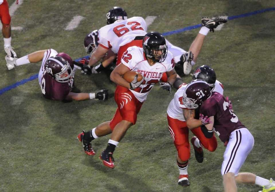 Newfield's #22 Julian Santiago makes a carry during