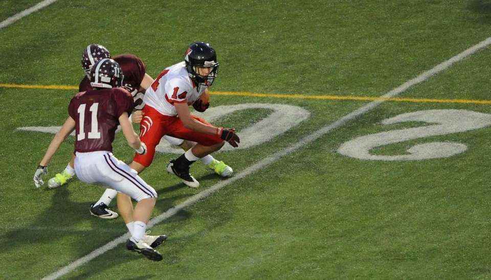 Newfield's #14 Dylan Harned scrambles with the ball