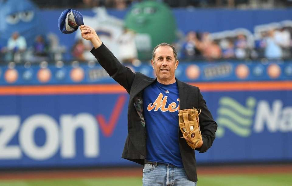 Comedian Jerry Seinfeld waves to fans before throwing