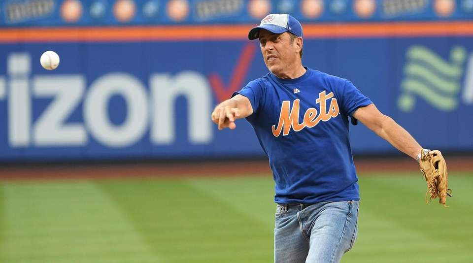 Comedian Jerry Seinfeld throws a ceremonial first pitch