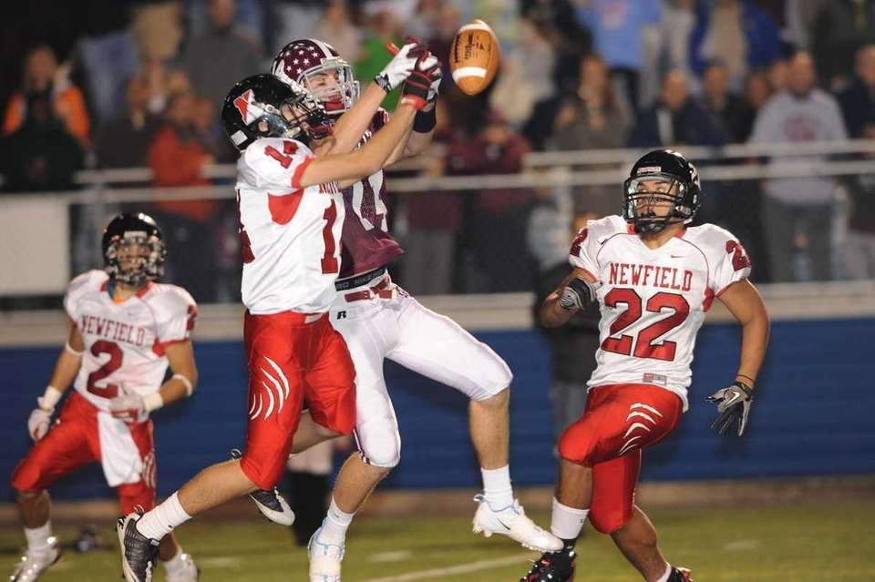 Newfield's #14 Dylan Harned, left, breaks up a