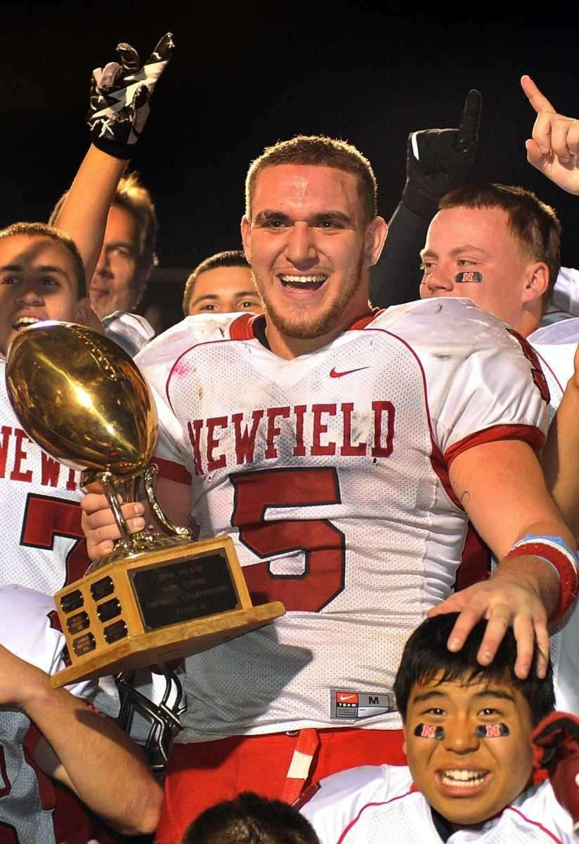 Newfield's #5 Ronald Denig holds the Long Island