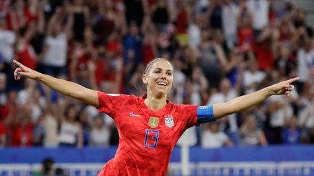 United States' Alex Morgan celebrates after scoring her