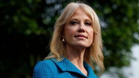 White House counselor Kellyanne Conway talks with reporters