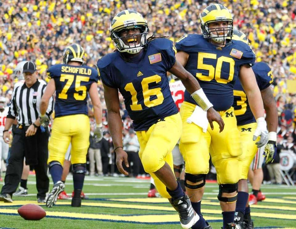 Denard Robinson #16 of the Michigan Wolverines celebrates