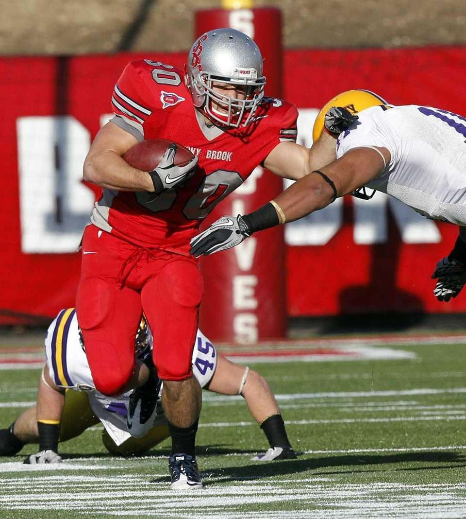 Stony Brook running back Brock Jackolski (30) breaks