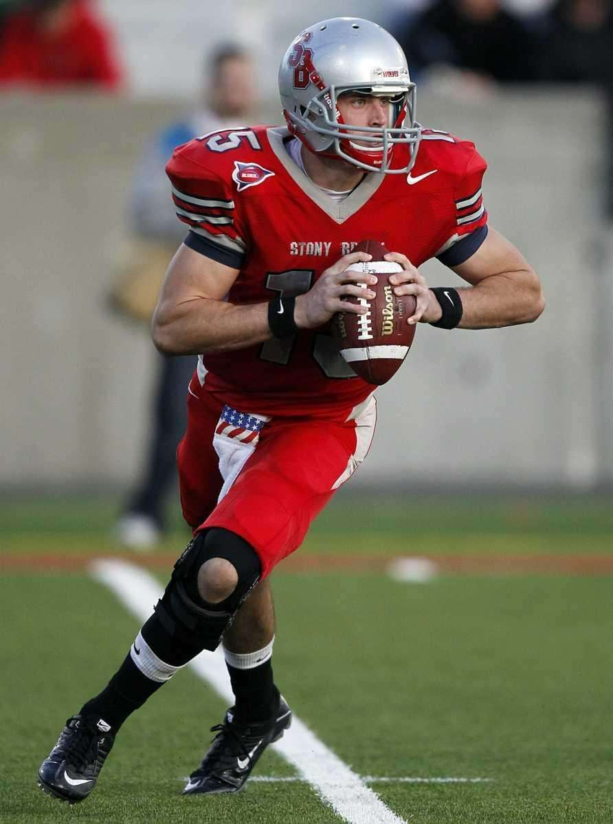 Stony Brook quarterback Kyle Essington (15) rolls out