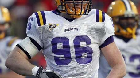 Albany defensive end Eddie Delaney (96), who played