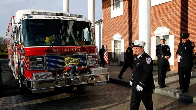 Firefighters from the Setauket Fire Department pass Rescue