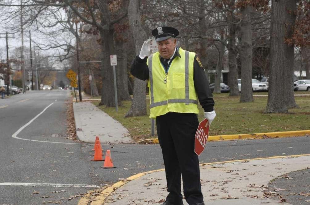 Bob McGarry, of Oakdale, waves to a passing