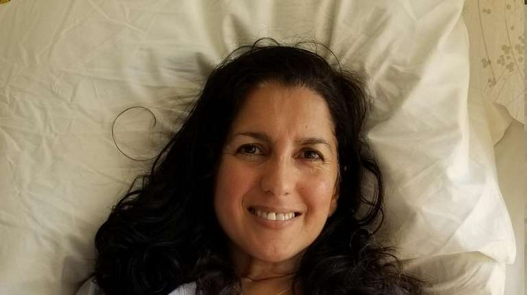 A smiling Lisa Calla of Smithtown post surgery