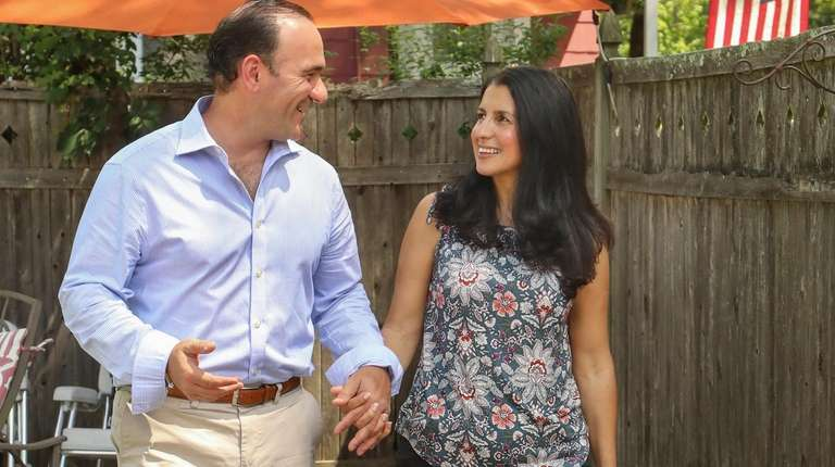 Lisa Calla, right, and her husband, Guy, outside