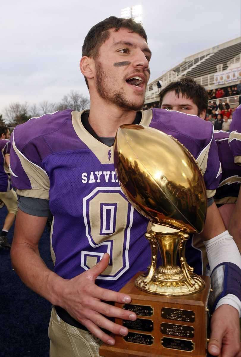 Sayville quarterback Steve Ferreira (9) with the championship
