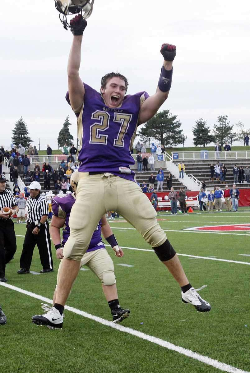 Sayville's John Haggart (27) jumps in the air