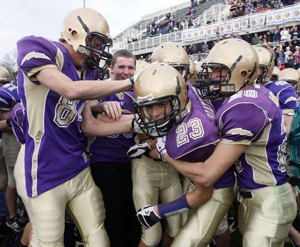 Sayville players begin to celebrate on the sidelines.