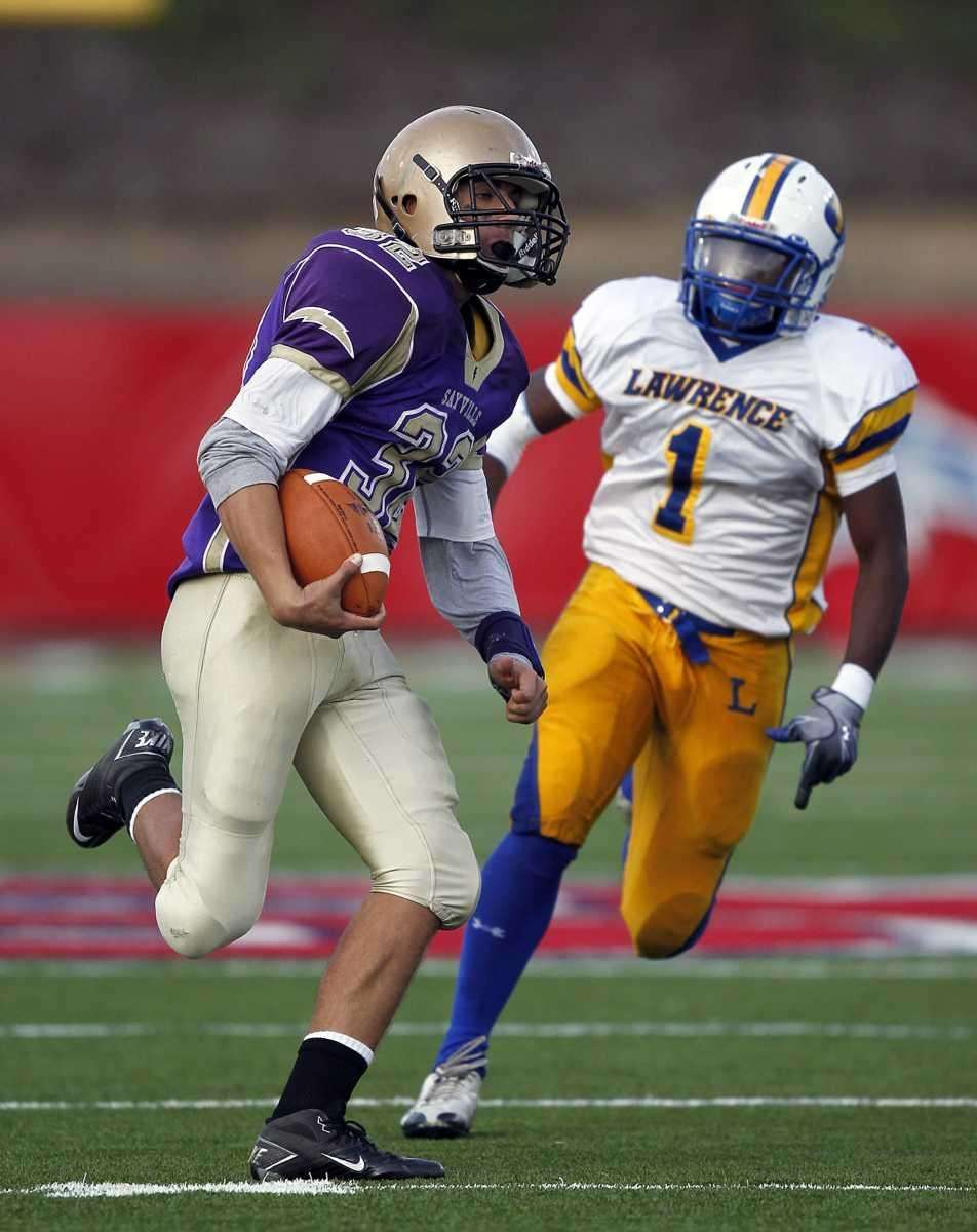 Sayville running back Zach Sirico (32) outruns Lawrence's
